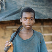 A 13-year-old cocoa worker in West Africa. [From the Robin Romano Archives of the University of Connecticut]/
